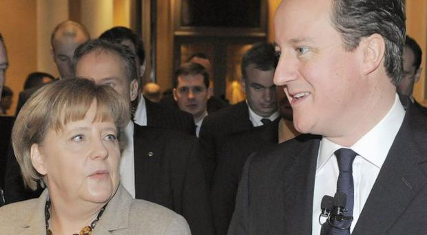Angela Merkel and David Cameron watch the markets closely