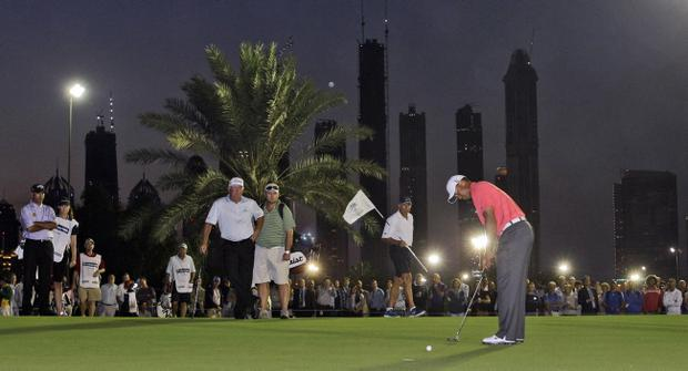 Tiger Woods plays a shot during the Challenge Match at the Emirates Golf Club yesterday ahead of the Dubai Desert Classic