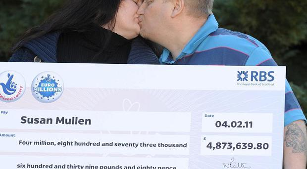 Susan and Lee Mullen celebrate their £4,873,639.80 EuroMillions win