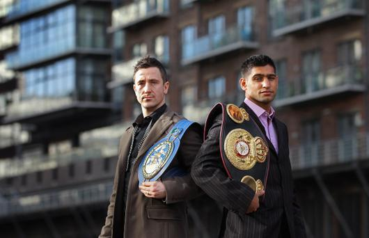 European titleholder Paul McCloskey and World champion Amir Khan square up at yesterday's press conference in Manchester