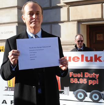 Quentin Willson delivers a letter to Chancellor George Osborne