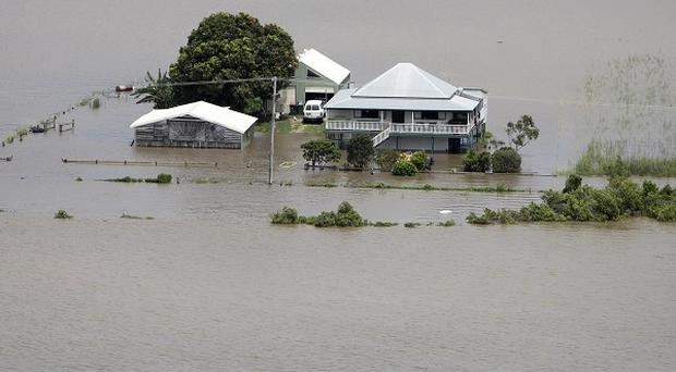 The Australian government has warned over the economic impact of recent floods and storms (AP)