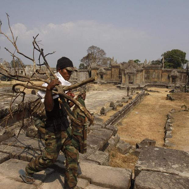 A Cambodian soldier carries firewood through the Cambodia's 11th century Hindu Preah Vihear temple (AP)