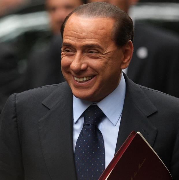 Italian premier Silvio Berlusconi faces prosecution over claims he paid for sex with a 17-year-old girl