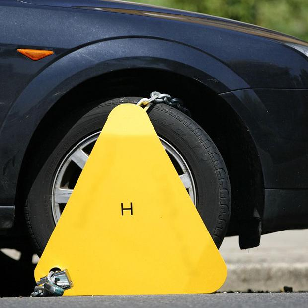 Cowboy clampers take up to 55 million pounds from drivers every year, the Home Office has said
