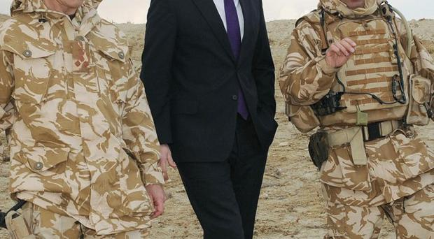 David Cameron with British soldiers at the Kabul Military Training Centre in Afghanistan