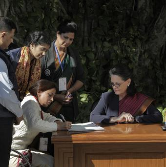 Congress party president Sonia Gandhi (right) is quizzed by census officials (AP)