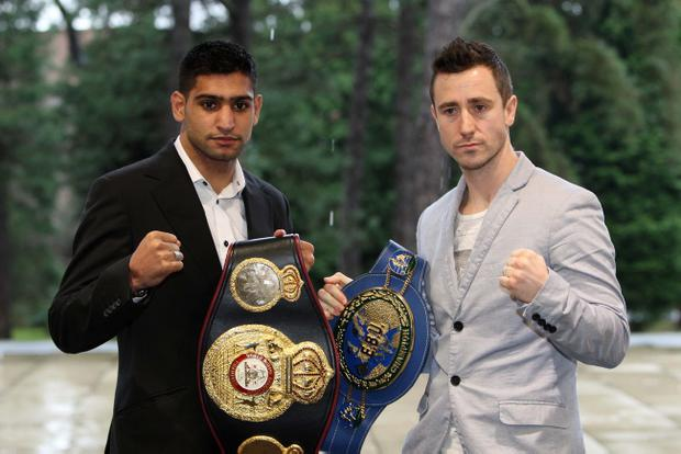 Amir Khan and Paul McCloskey pose for pictures at the Ulster Museum in Belfast, where they promoted their forthcoming world title fight, scheduled for Manchester's MEN Arena on April 16