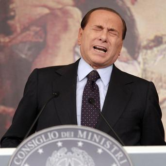 Italian premier Silvio Berlusconi reacts following a Cabinet meeting at Rome's Chigi palace (AP)