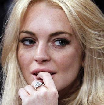 Lindsay Lohan has been charged with the theft of a necklace, US prosecutors said