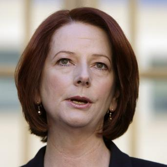 Australia's prime minister Julia Gillard has introduced tax legislation to Parliament