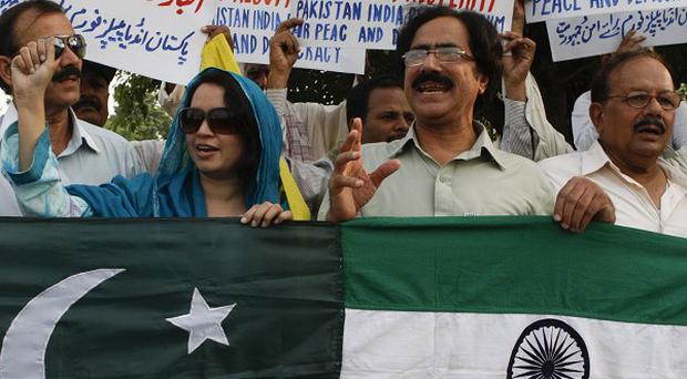 The governments of India and Pakistan have agreed to resume wide-ranging peace talks (AP)