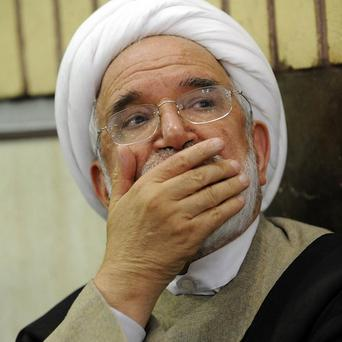 Iranian opposition leader Mahdi Karroubi has been placed under house arrest