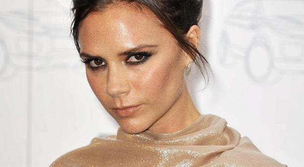 Victoria Beckham has a topless pic of hubbie David as her phone screen saver
