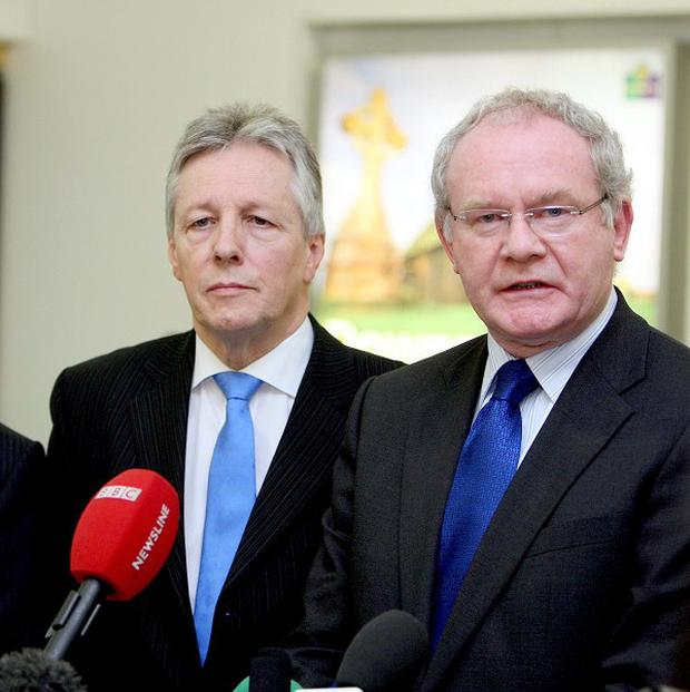 Northern Ireland First and Deputy First Ministers Peter Robinson and Martin McGuinness speak to the media at Belfast City Airport