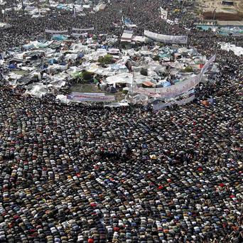 Anti-government protesters at Friday prayers in Tahrir Square, Cairo, Egypt (AP)