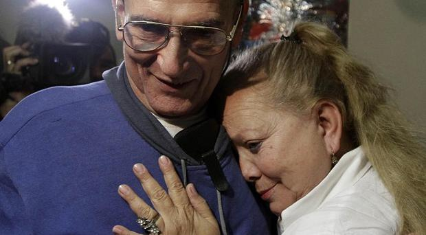 Cuba's dissident Hector Maseda embraces his wife Laura Pollan after being released from jail in Havana (AP)