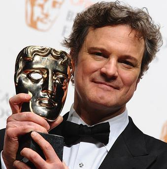 Colin Firth with the Best Actor award for his role in The King's Speech