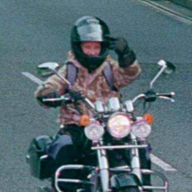 Motorcyclist Paul Collins gestures at a speed camera as he was caught speeding in Southampton last October