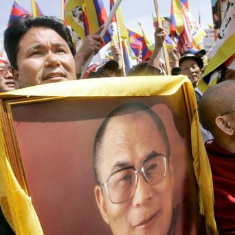 Jigme Norbu, left, nephew of the Dalai Lama, at a rally for Tibetan freedom in San Francisco (AP)