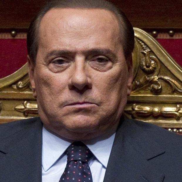 Silvio Berlusconi has been charged with paying for sex with a 17-year-old girl (AP)