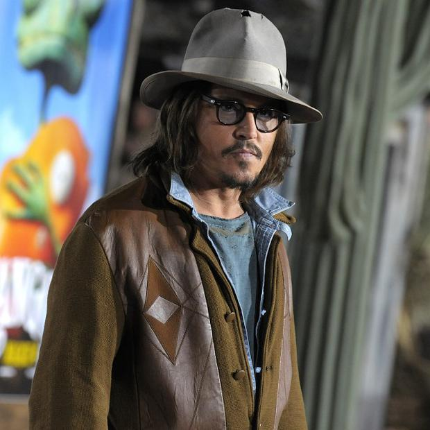 Johnny Depp spent Valentine's Day at the Rango premiere