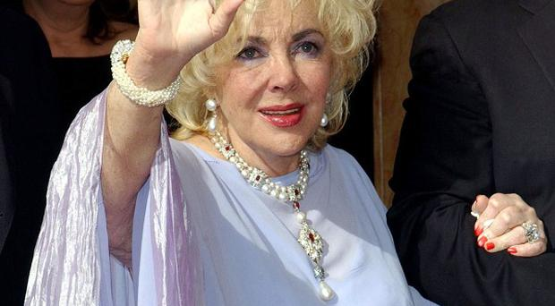Dame Elizabeth Taylor's condition is said to be 'improving'