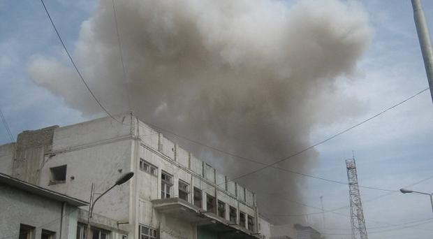 Smoke rises from a bank in Jalalabad, east of Kabul in Afghanistan (AP)