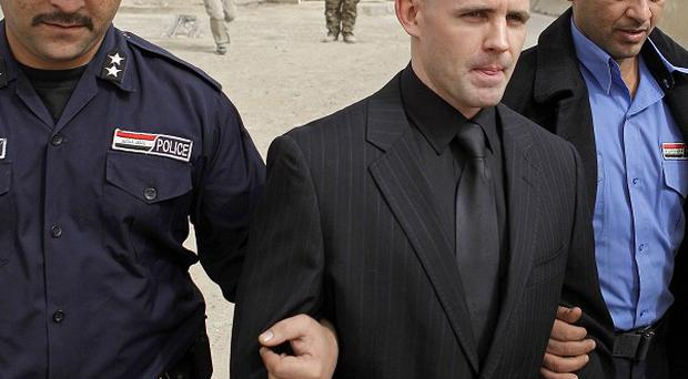 Danny Fitzsimons, center, walks out of an Iraqi court in Baghdad (AP)