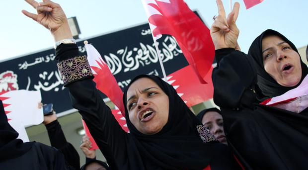 MANAMA, BAHRAIN - FEBRUARY 20: With most school closed, teachers join anti-government protesters at the Pearl roundabout on February 20, 2011 in Manama, Bahrain. Protesters filled the square for another day, as the government and oppostion leaders engaged in talks to resolve the weeklong uprising. (Photo by John Moore/Getty Images)