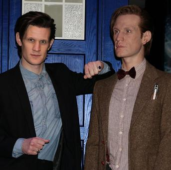 Matt Smith poses next to the Tardis and a life size scale model of Doctor Who