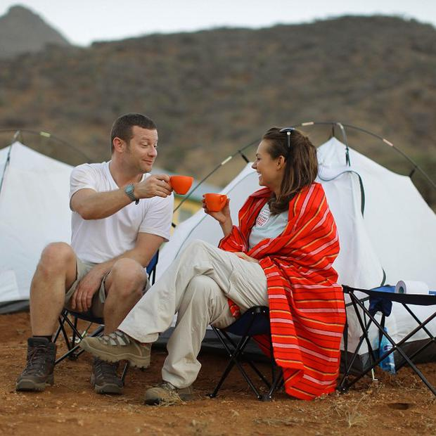 Dermot O'Leary and Kara Tointon as they share a cup of tea before the start of the BT Red Nose Desert Trek in aid of Comic Relief