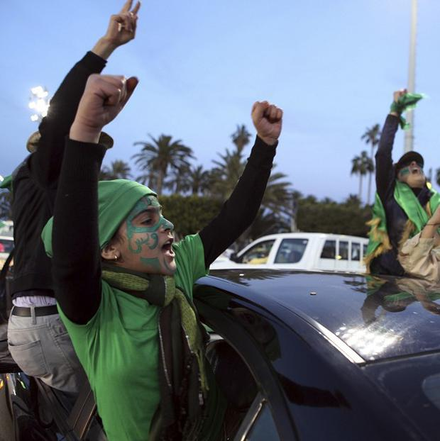 Six Irish workers are believed to be in Libya's second city where government troops reportedly opened fire on protesters