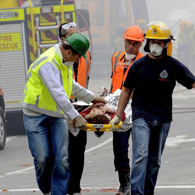 An injured person is carried by rescue workers after an earthquake rocked Christchurch, New Zealand (AP)