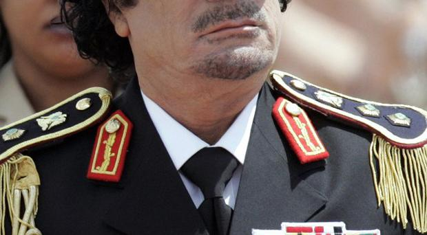 Colonel Muammar Gaddafi has vowed to die a martyr (AP)