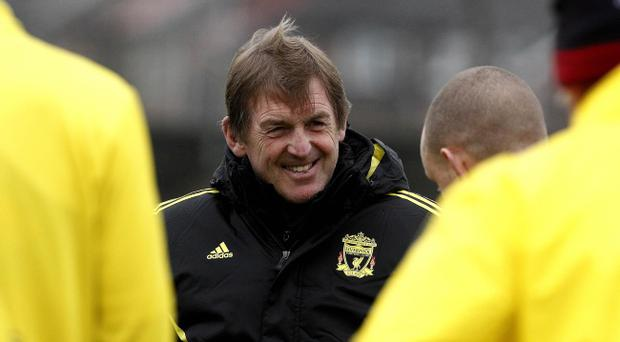 Kenny Dalglish was all smiles at Liverpool's training session yesterday