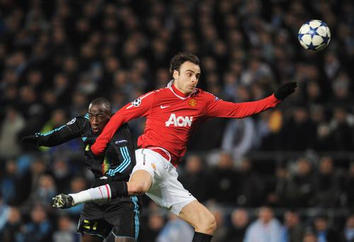 MARSEILLE, FRANCE - FEBRUARY 23: Dimitar Berbatov of Manchester United is challenged by Souleymane Diawara of Marseille during the UEFA Champions League round of 16 first leg match between Marseille and Manchester United at the Stade Velodrome on February 23, 2011 in Marseille, France. (Photo by Michael Regan/Getty Images)