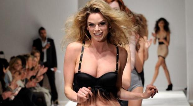 Models walk the runway during the Triumph Show at London Fashion Week