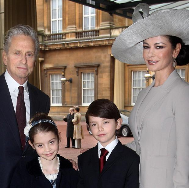 Hollywood actress Catherine Zeta Jones and her husband Michael Douglas, with their children Dylan and Carys