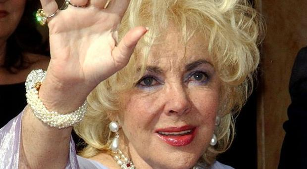 Dame Elizabeth Taylor's doctors continue to be encouraged by her progress as she remains in hospital in Los Angeles