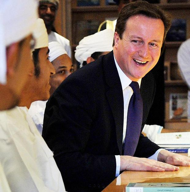Prime Minister David Cameron at the Grand Mosque in Muscat, Oman, on the final leg of his Middle East tour