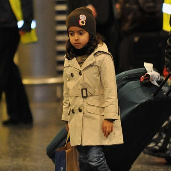 Five-year-old Hala Mansouri, from Nottingham, arrives with her family at Gatwick Airport after being evacuated from Libya