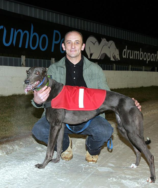 Winning trainer Kenny Bell with Gazunder after taking the War on Want 50 Years Fighting Poverty 525 at Drumbo Park