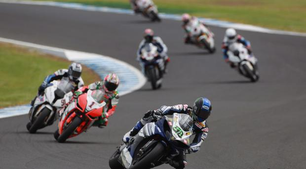 Eugene Laverty guides his Yamaha ahead of the chasing pack at Phillip Island yesterday