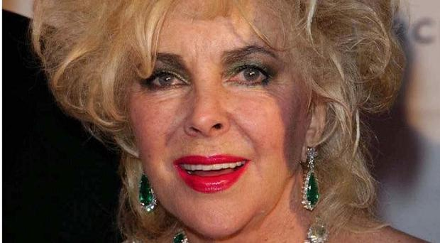 Dame Elizabeth Taylor will be watching the Oscars from hospital