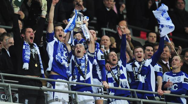 LONDON, ENGLAND - FEBRUARY 27: Stephen Carr of Birmingham City lifts the trophy after victory during the Carling Cup Final between Arsenal and Birmingham City at Wembley Stadium on February 27, 2011 in London, England. (Photo by Shaun Botterill/Getty Images)