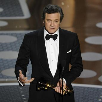 Colin Firth accepts the Oscar for best performance by an actor in a leading role for The King's Speech at the 83rd Academy Awards (AP)