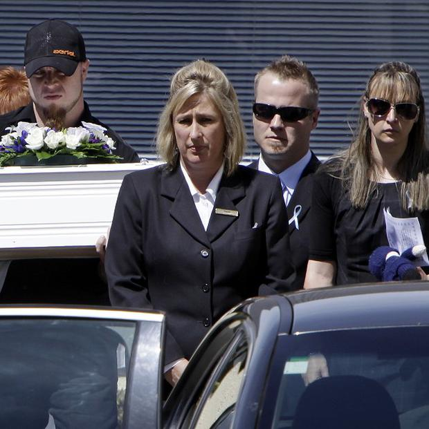 The coffin of five-month-old Baxtor Gowland is carried from a service in Christchurch (AP)