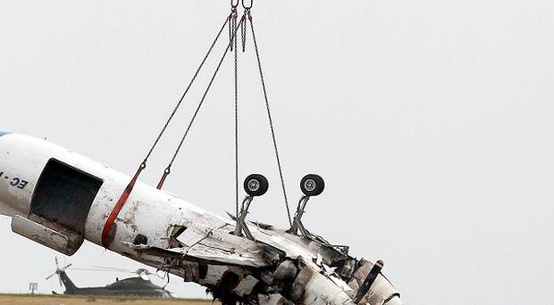 The wreckage of the Manx2 plane in which six people were killed in a crash is removed from the runway at Cork Airport