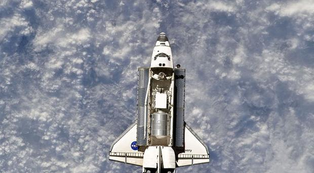 A spacewalk by crew from the space shuttle Discovery is planned at the International Space Station (AP)